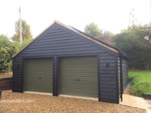 30 Degree tiled roof and wood clad lifestyle building with double roller doors on front