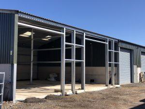 Installation of steel columns to split 2no open bays